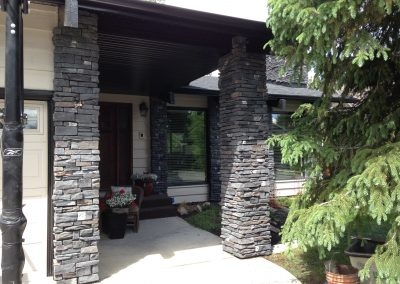 residential rundle stone front entry brick work